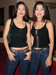 Cute Thai twins pose and have fun for the camera