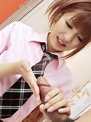 Kotone Aisaki Asian in school uniform rubs erect dick of her palm