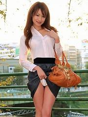 Asian hottie shows off her delicious body in a silver bikini