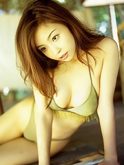 Long haired asian babe posing with her delicious body in a bikini
