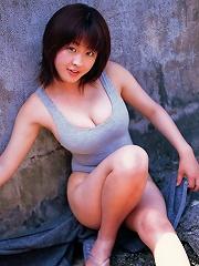 Seductive asian hottie exhibits her big juicey boobs in a bikini