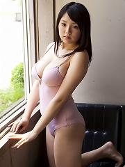 Busty asian babe is incredibly inticing in her pink lingerie