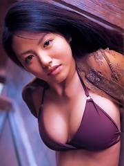Flirtatious asian idol with large melons spilling from her bikini
