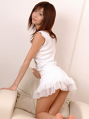 Adorable asian babe teases and allures in her short white skirt