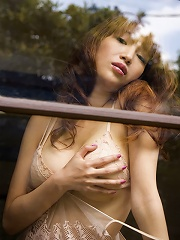 Sexy and alluring gravure idol chick melts in her lingerie