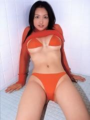 Stacked asian gravure hottie posing in her skimpy little bikinis