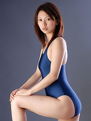Long haired asian beauty posing in a blue one piece swim suit