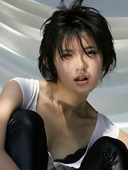 Mari Hoshino is a sexy glamour model posing in her minidress