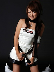 Adorable energetic asian babe posing in a short mini skirt
