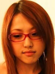 Japanese babe Rino Mizusawa in glasses toying her pussy