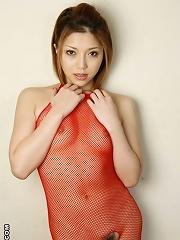 Sweet Japanese hottie Aki Anzai is posing in fishnet lingerie