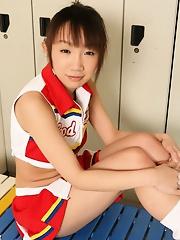 Young schoolgirl Ai Yumemi is posing