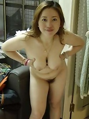 Natural breasts chinese hottie gets naked and show her pussy
