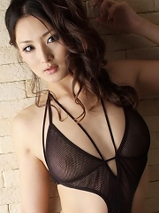 Hot Japanese model Risa in a naughty black swimsuit